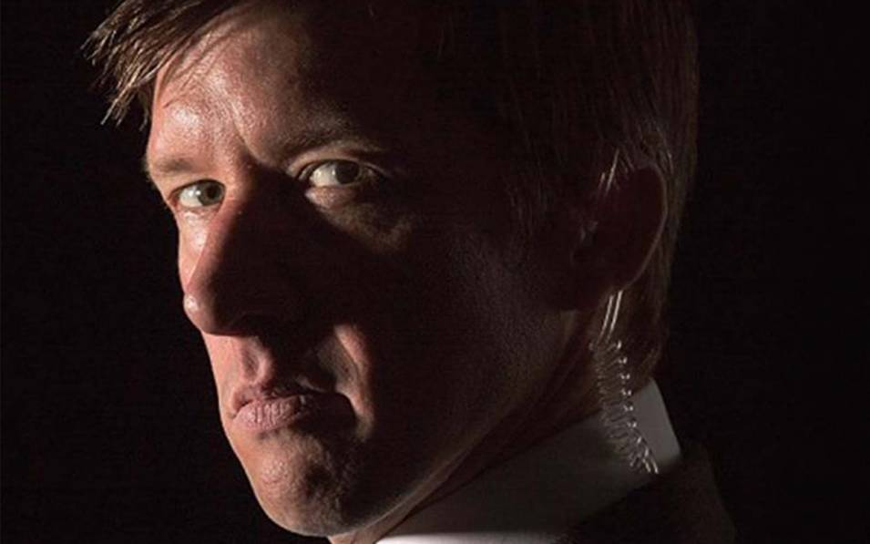 Jonathan Pie staring intensely in a shadowy background