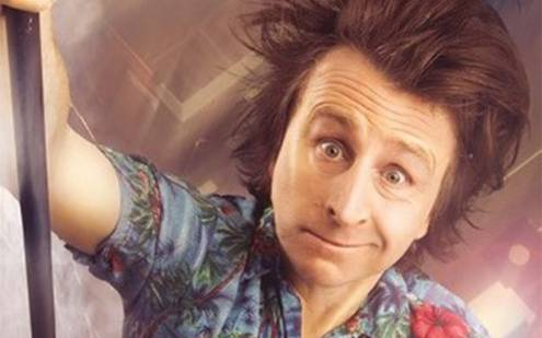 Milton jones pulling face holding a pole