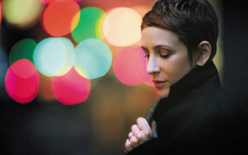 Stacey Kent in the coloured lights of evening.