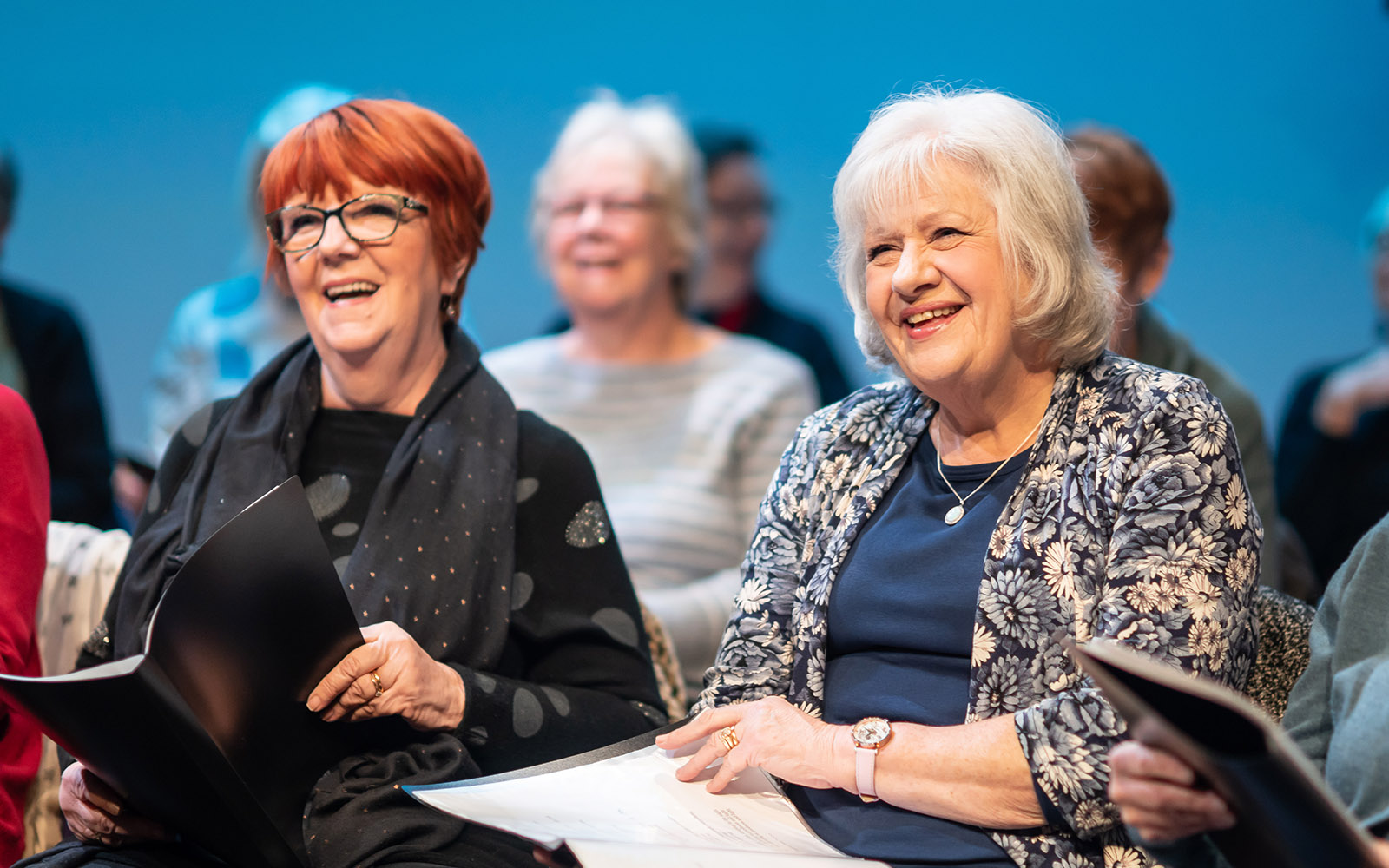 Two women from the community choir smiling