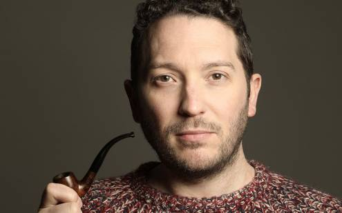 Jon Richardson posing with a pipe
