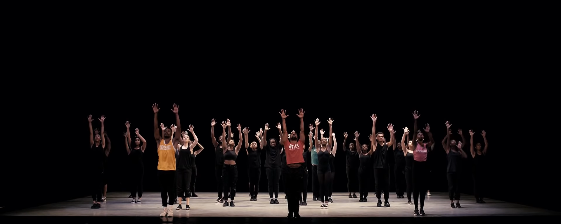 Ailey Masterclass_Dancers on a stage with their hands in the air
