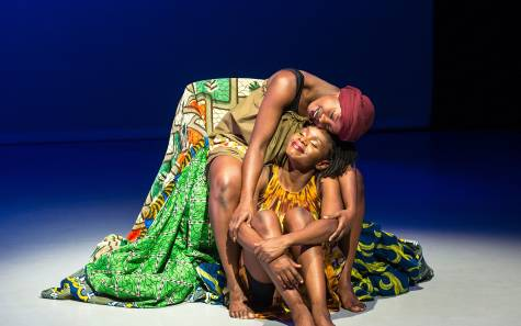 UD, The Head Wrap Diaries, The Place_Two performers embracing on stage.