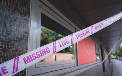 Pink Tape wrapped around Norwich Theatre Royal with the message: Missing Live Theatre