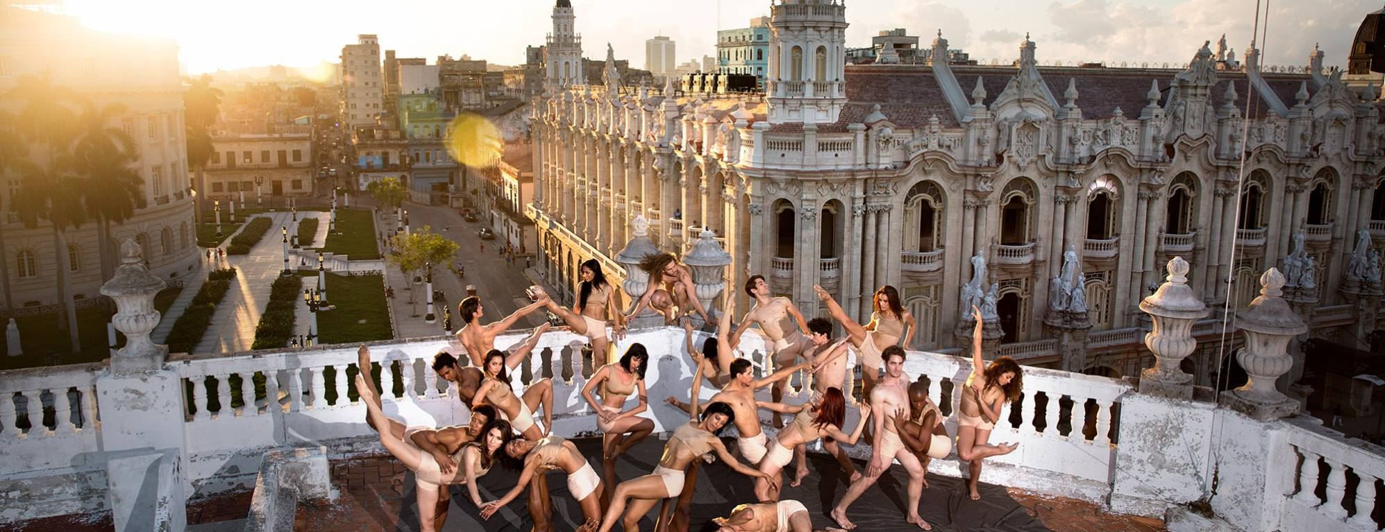 Acosta Dancers posing on the roof of a building in Cuba